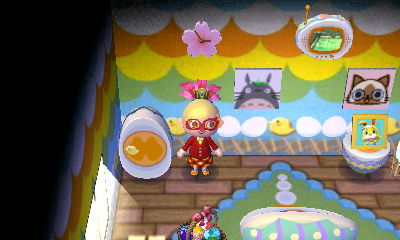 The Sakura Clock DLC (above Taiga) in the egg room (Totoro and Airou are patterns)