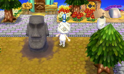 We got our Moai statue. I'm surrounding it with red flowers. Why? Because I can.