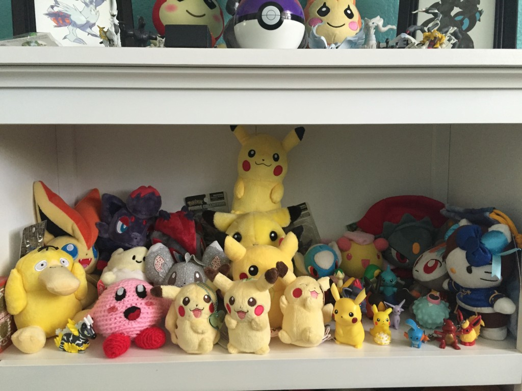2nd shelf. Mostly pikachu. Handmade kirby, Chun Kitty. Stuff.