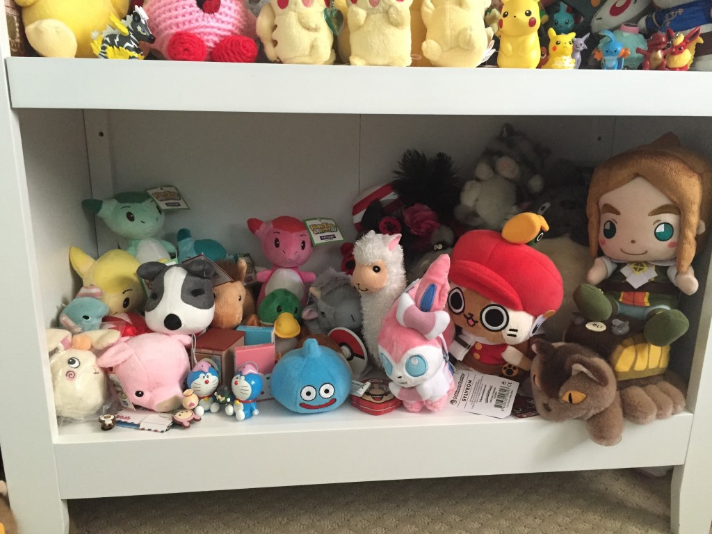 Bottom Shelf: Lots of Harvest Moon plushies. DQ Slime, Monster Hunter mail airou from capcom cafe in Tokyo, cat bus, Prince Pietro from Popolocrois